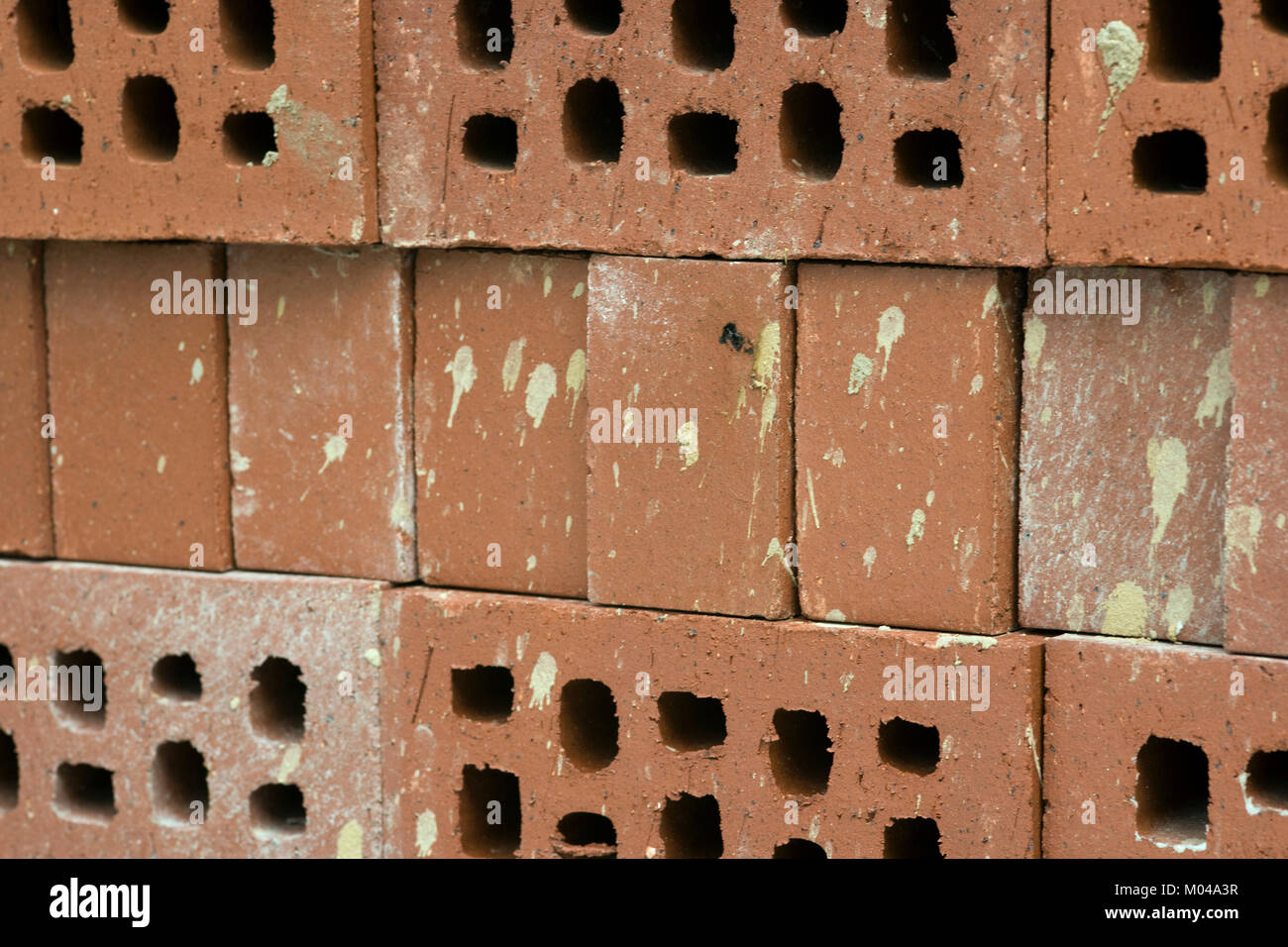 New but dirty semi-engineering bricks construction background - Stock Image