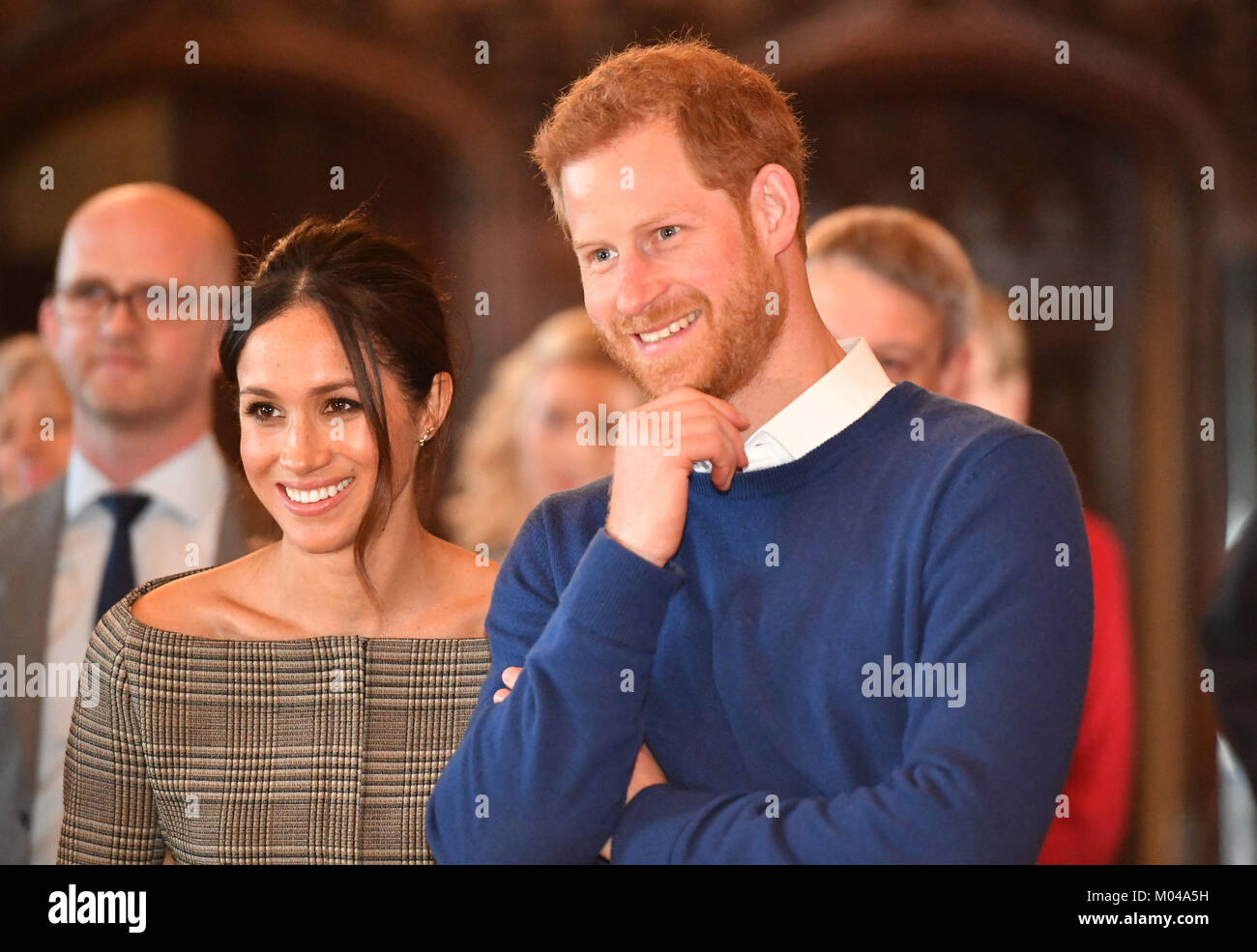 Prince Harry and Meghan Markle watch a performace during a visit to Cardiff Castle. Stock Photo