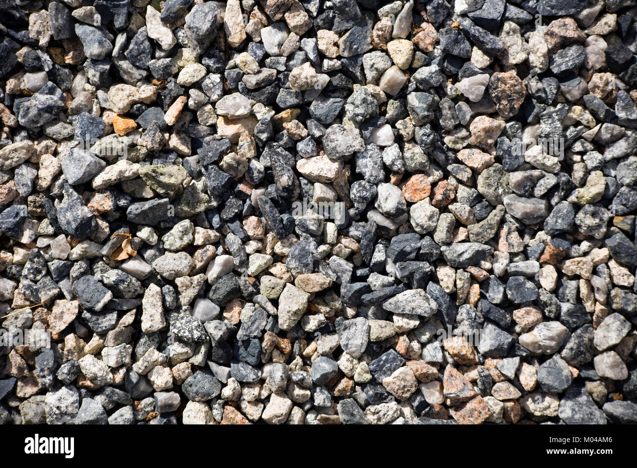 Granite chippings hard landscaping surface - Stock Image