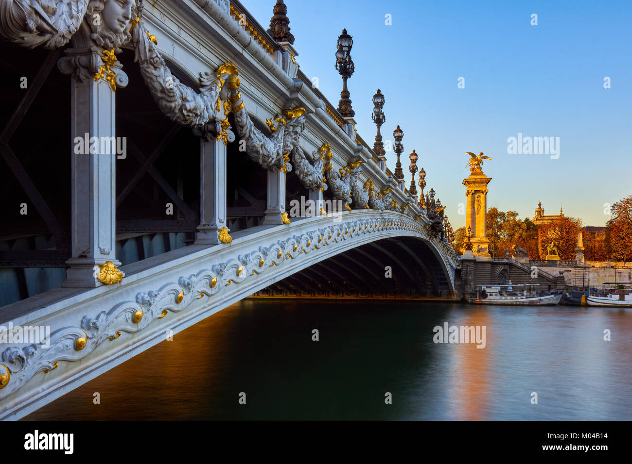 Pont Alexandre III bridge and Seine River at sunset. 8th Arrondissement, Paris, France - Stock Image