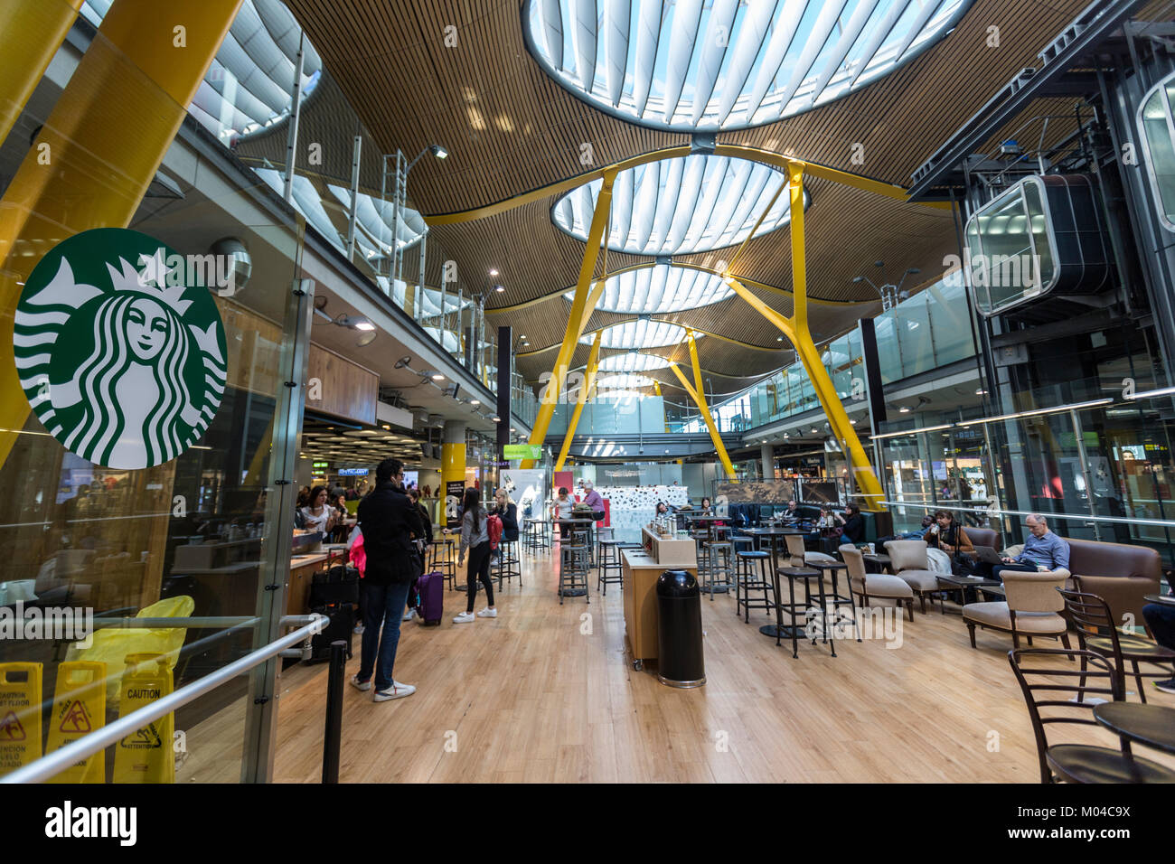 Starbucks cafe in Adolfo Suárez Madrid–Barajas Airport  terminals T4, designed by architects Antonio Lamela - Stock Image