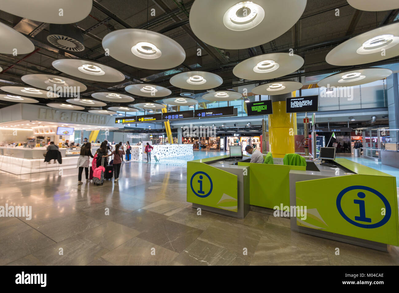 Adolfo Suárez Madrid–Barajas Airport  terminals T4 information desk, designed by architects Antonio Lamela - Stock Image