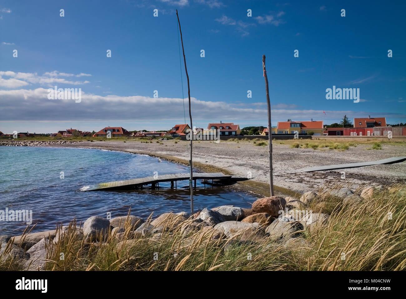 beach and wooden jetty on coast near Skagen Denmark - Stock Image