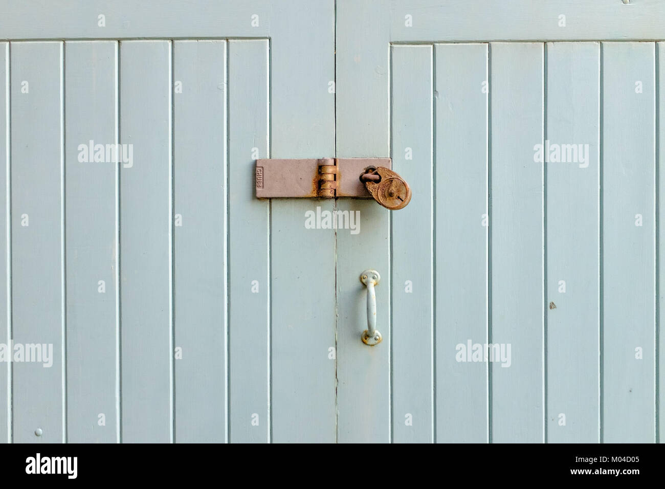 Egg shell blue painted wooden door with Chubb padlock for security & Egg shell blue painted wooden door with Chubb padlock for security ...