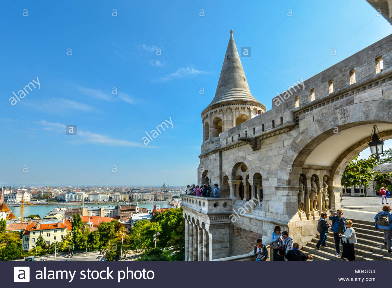 Tourists enjoy the fairy tale towers at Fisherman's Bastion overlooking the Danube River at Budapest Hungary's Castle Stock Photo