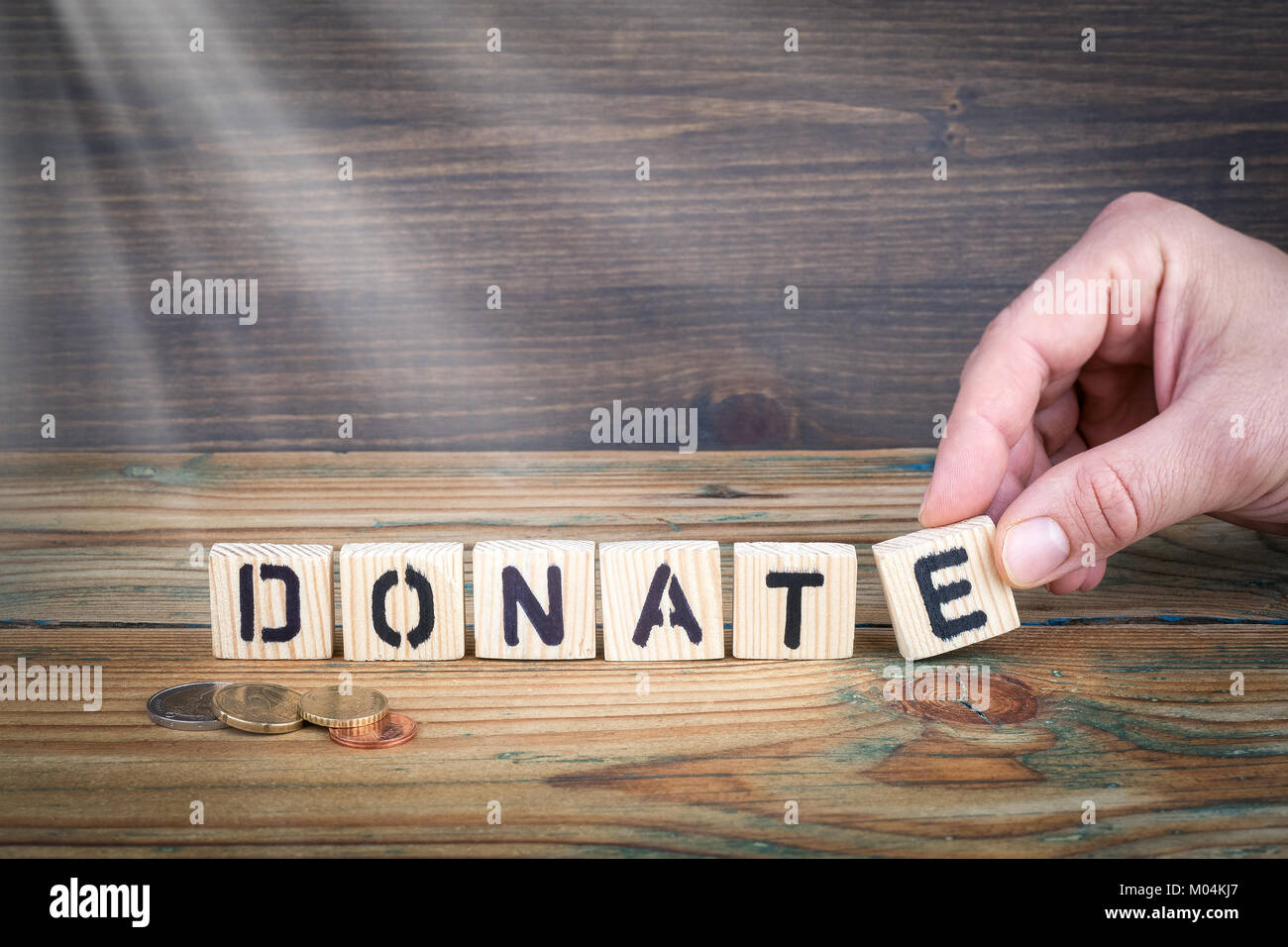 donate. Wooden letters on the office desk, informative and communication background - Stock Image