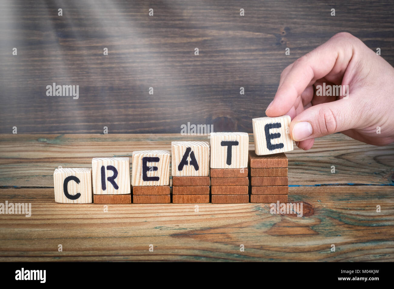 create. Wooden letters on the office desk, informative and communication background - Stock Image