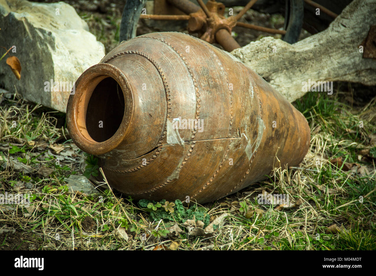 Old antique faience churn pot to make a butter from milk. - Stock Image
