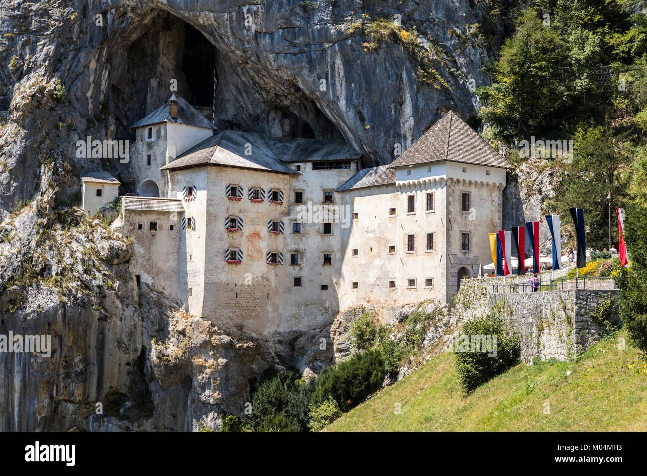 Predjama Castle (Predjamski grad), a Renaissance castle built within a cave mouth in the historical region of Inner - Stock Image