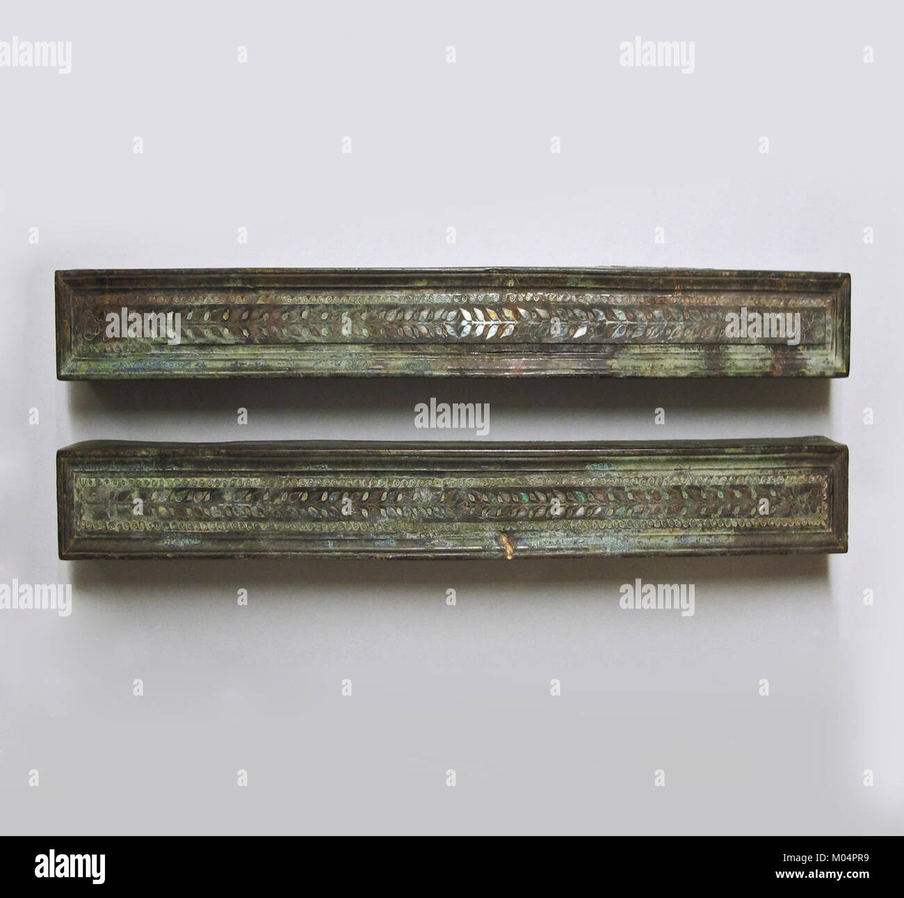 Bronze furniture attachments with silver inlay MET SF1723031abedited Stock Photo
