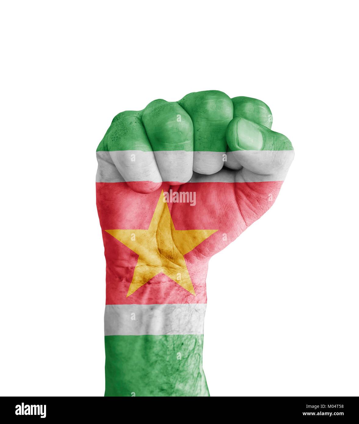 Flag of Suriname painted on human fist like victory symbol - Stock Image