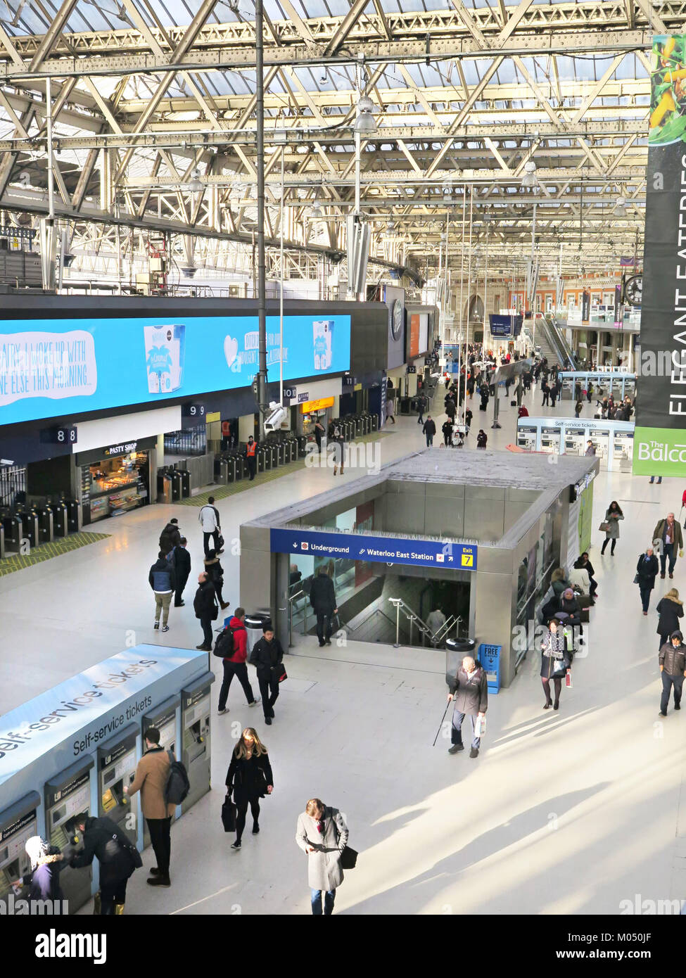 Waterloo Station, entrance to the the tube along side the trains, London britain - Stock Image