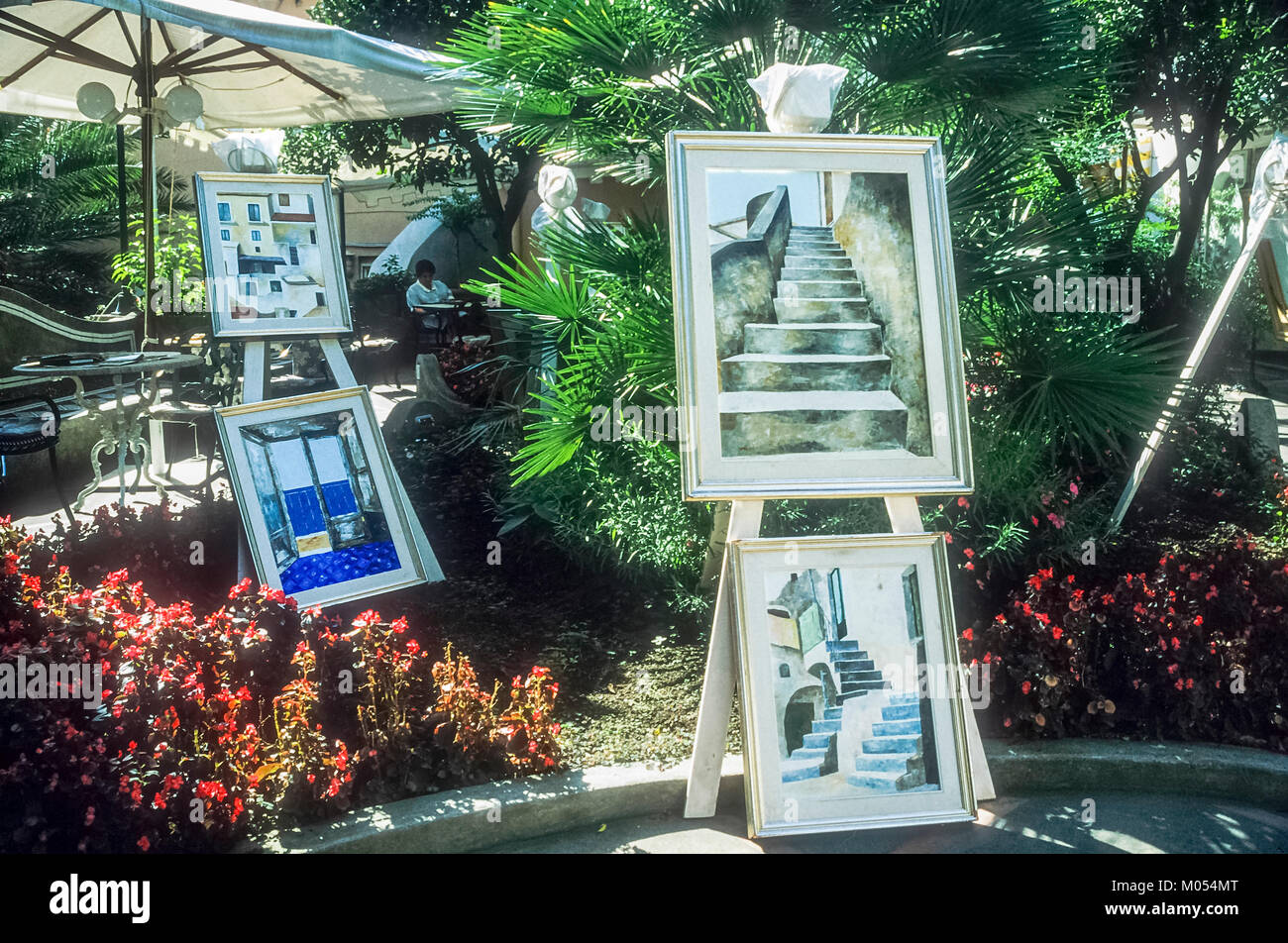Art works on display in the centre of the village of Positano, Italy. - Stock Image
