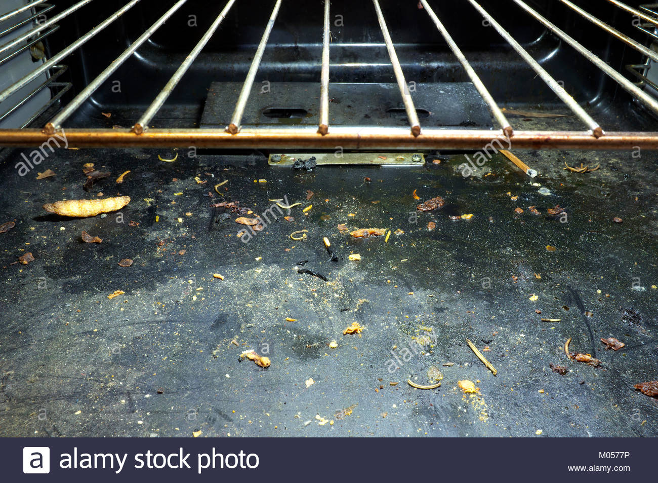 Interior of a dirty unclean domestic gas oven. - Stock Image