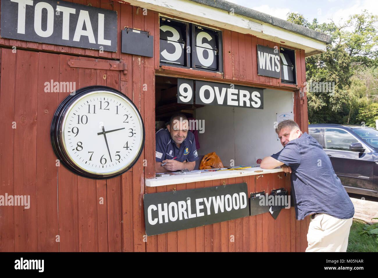 Scoring shed at Saturday match at Chorleywood Cricket Club, Chorleywood, Hertfordshire, England, United Kingdom Stock Photo