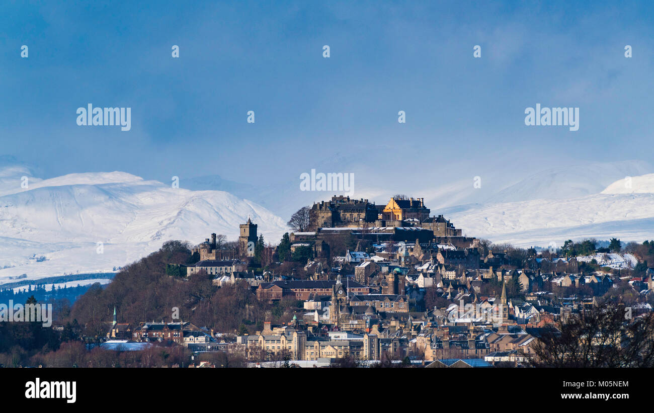 View of Stirling Castle with snow covered mountains in distance, Scotland, United Kingdom. - Stock Image