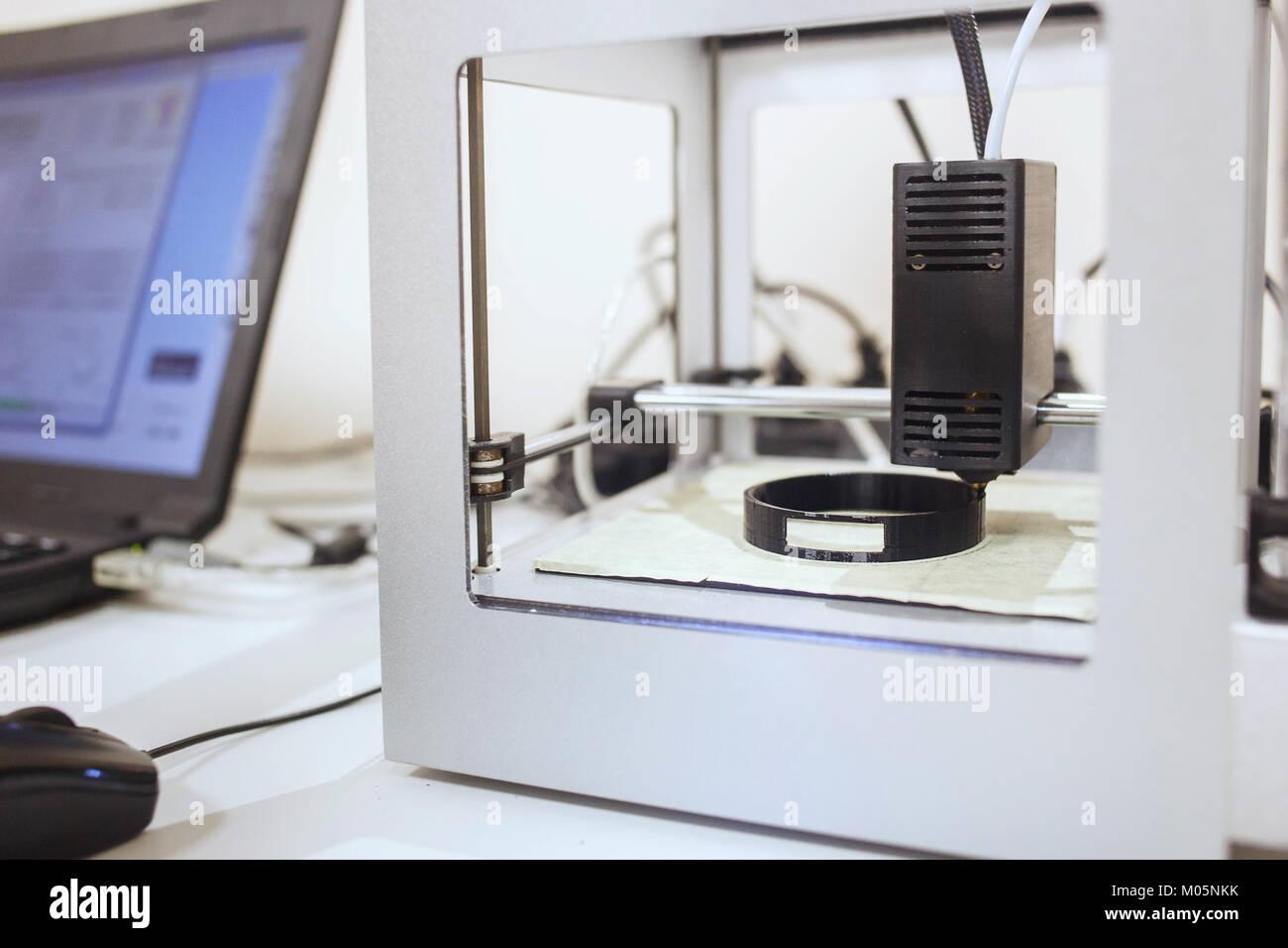 3d printer printing. Close up process of printing technology Stock Photo