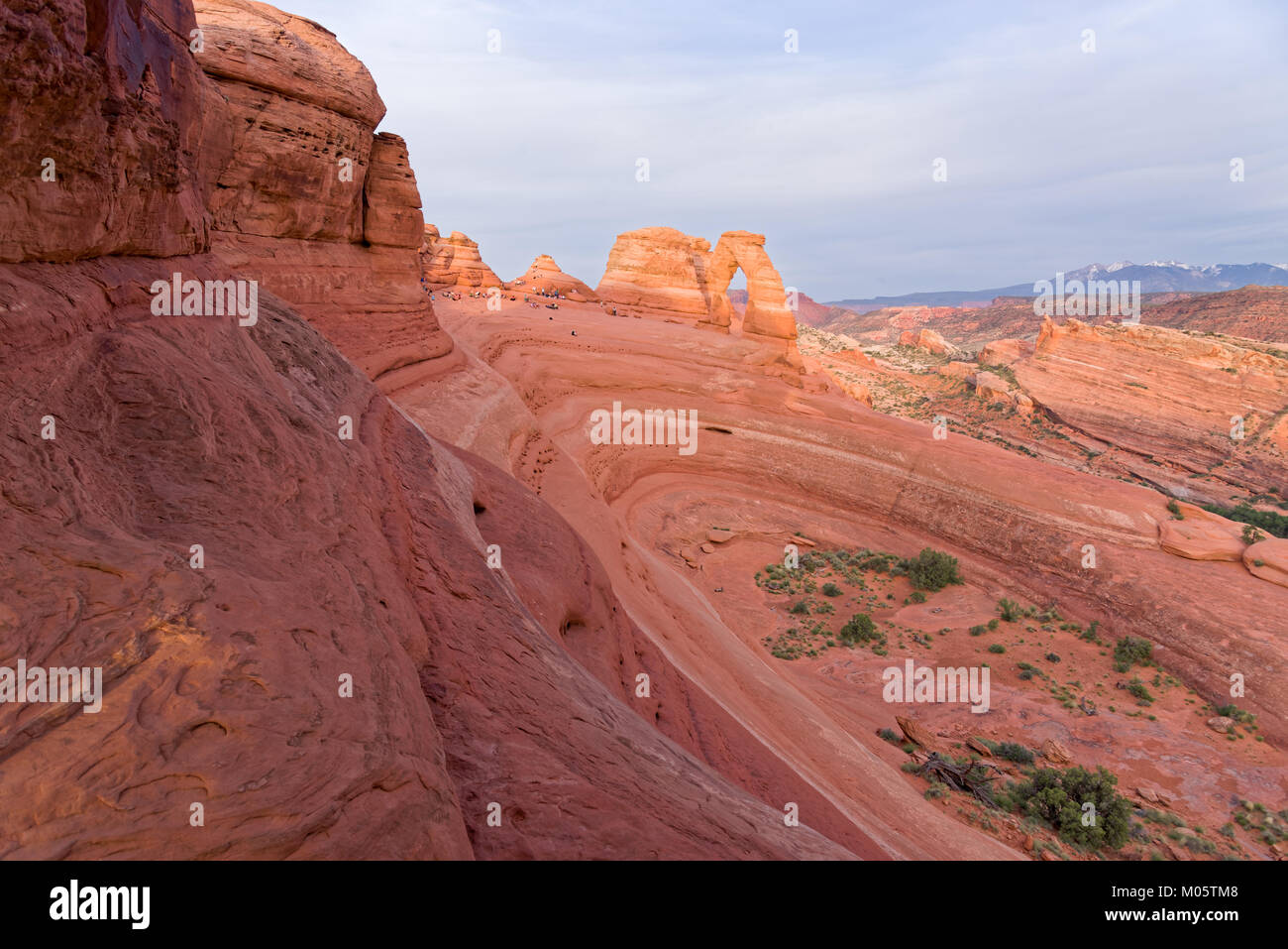 Delicate Arch, UT, USA, June 06 2015 : Tourists and photographers wait for the light at Delicate Arch. Red sunset. - Stock Image