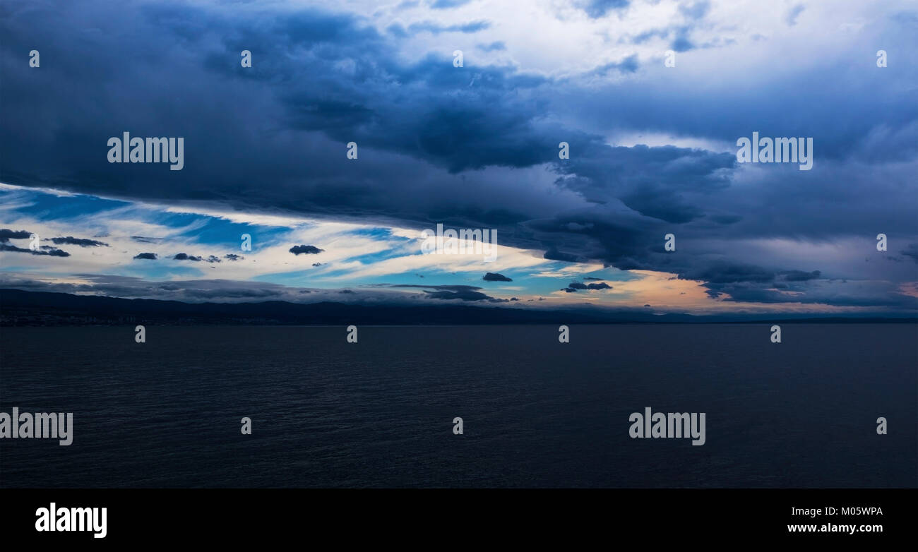 A passing storm above the bay in the Adriatic Sea - Stock Image