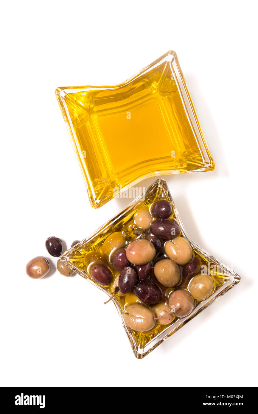 Olives with olive oil isolated on a white background. - Stock Image