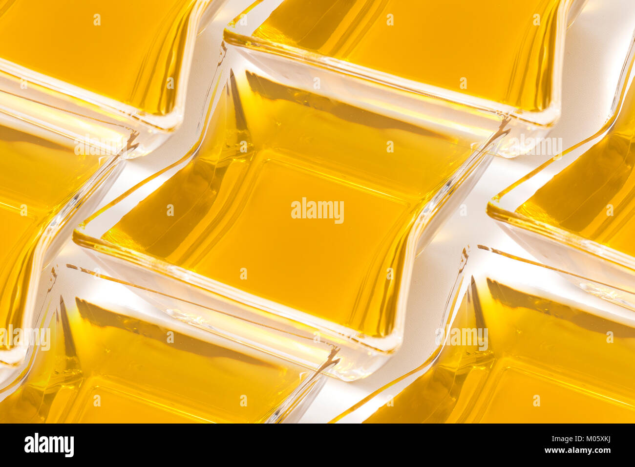 Aligned olive oil glass container  concept. - Stock Image