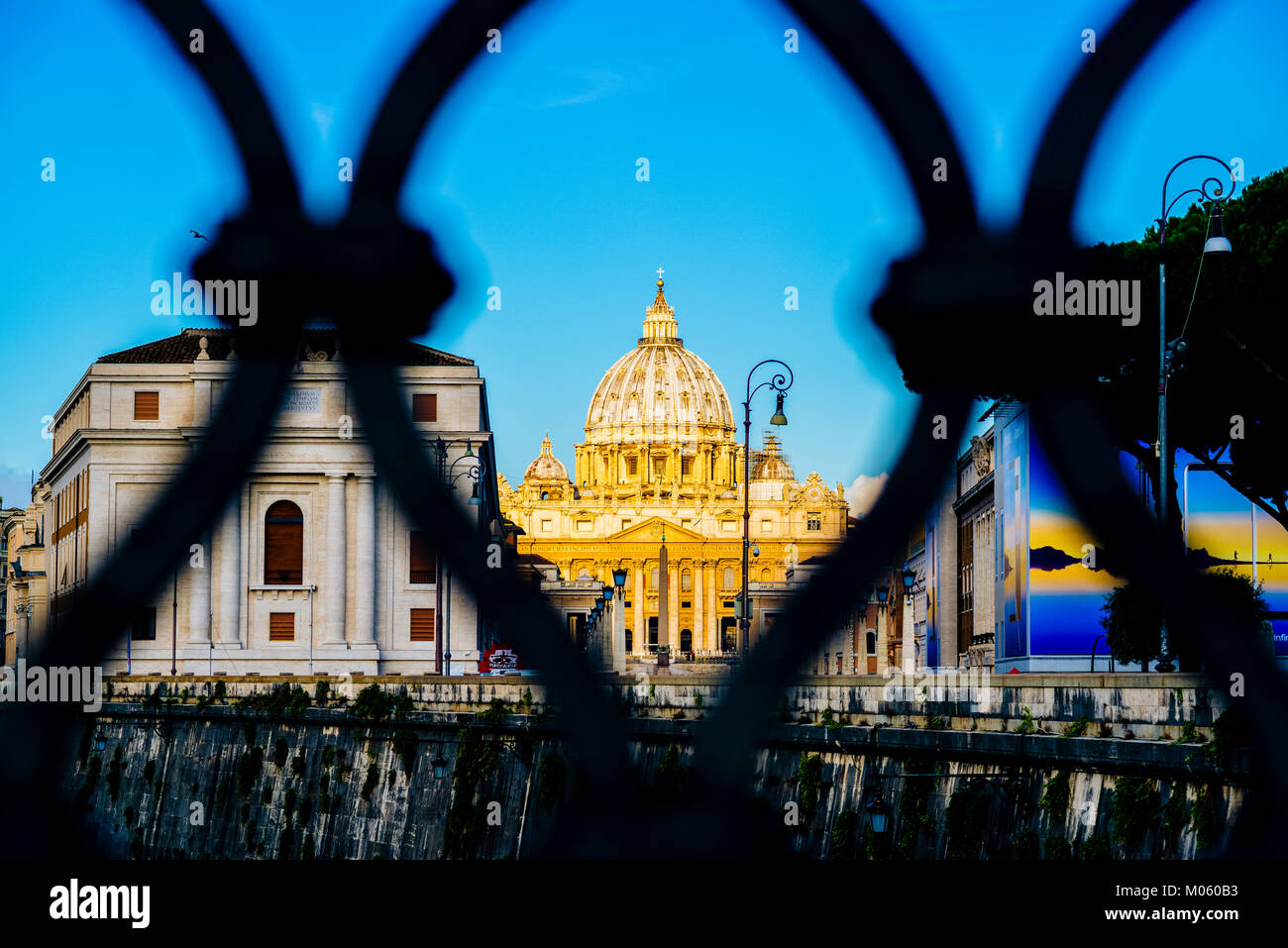 Italy, Rome, City of the Vatican dome of San Pietro seen from the bridge over the Tiber River - Stock Image