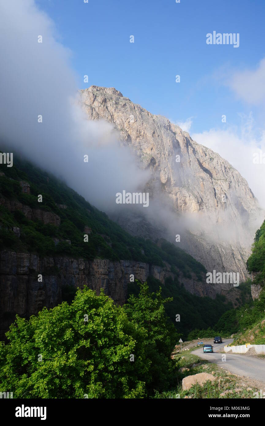 white cloud over Khinalig mountain. high up in the mountains in Quba  rayon in northeastern Azerbaijan. - Stock Image