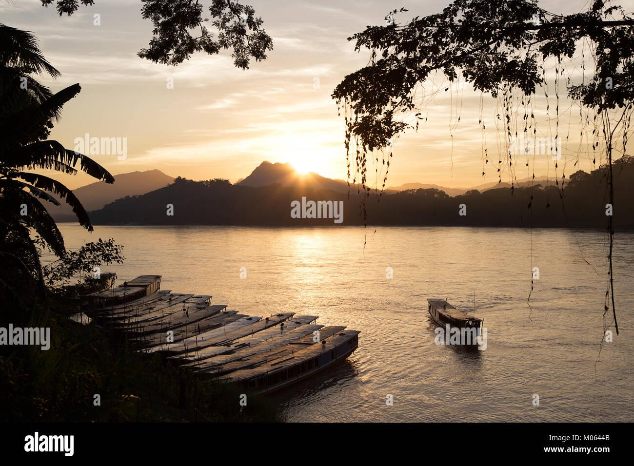 Sunset at Mekong River in World Heritage Town Luang Prabang, Laos - Stock Image