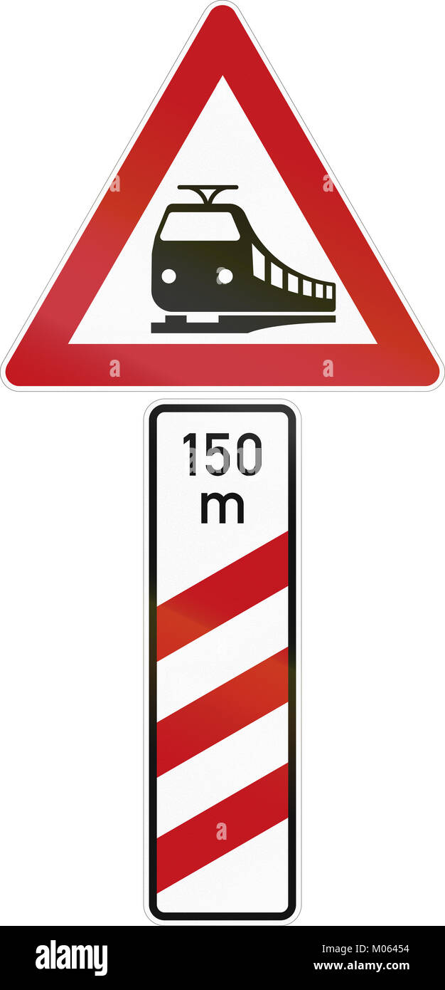 German level crossing distance marker for the right side of the road with warning sign. - Stock Image