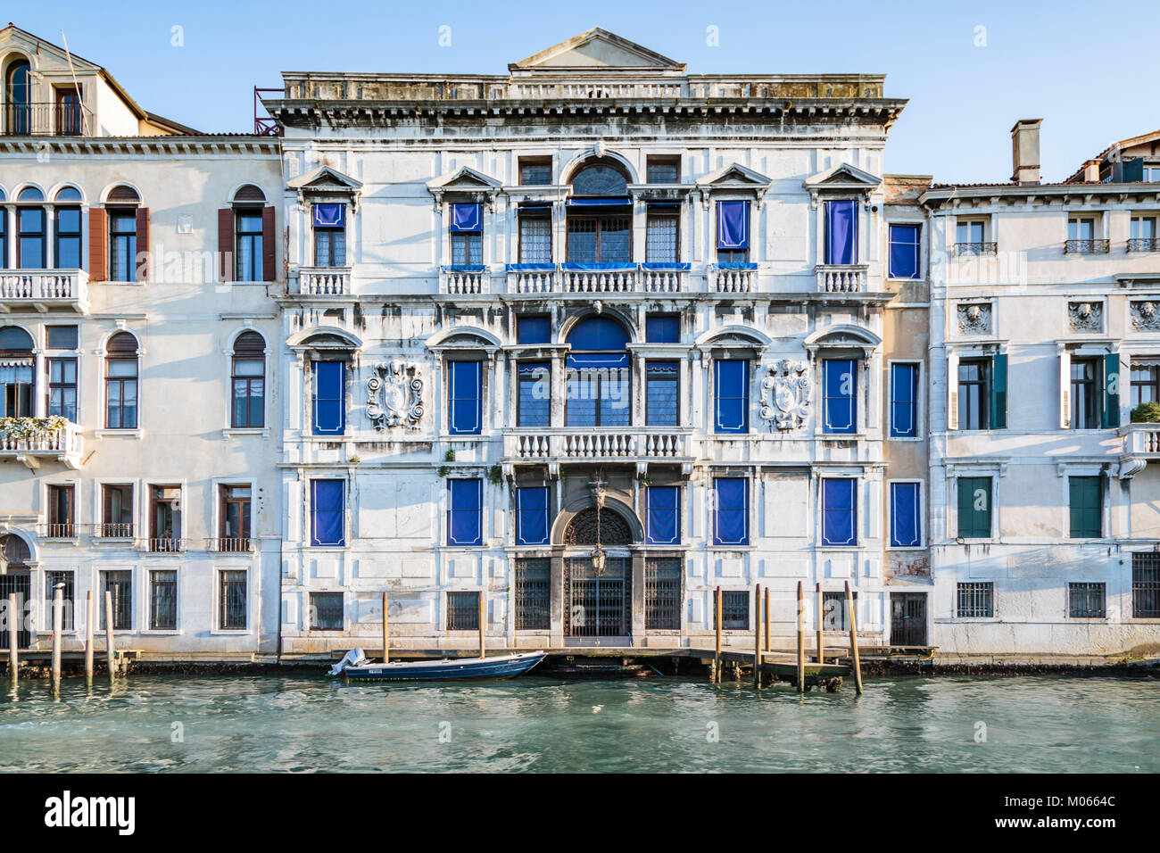 Buildings boats and gondolas along the Grand Canal waterway in Veneto, Venice, Italy, Europe, - Stock Image