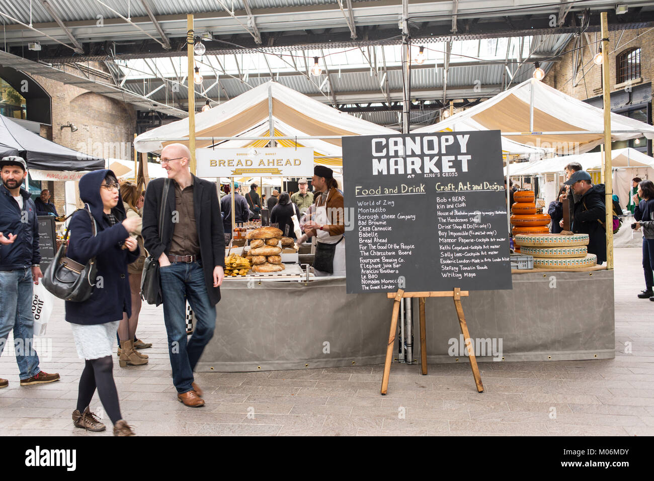 People visiting the the Canopy Market, King's Cross, London. Canopy market is a pop-up market near Granary Square - Stock Image