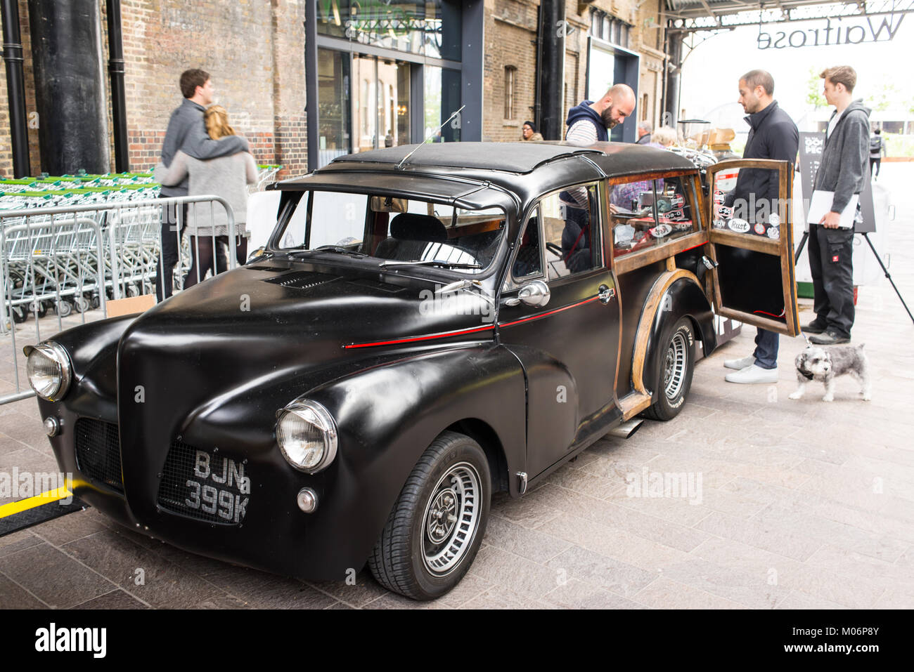 Cool hipster stall serving coffee set in a vintage car at the Canopy Market, King's Cross, London. Canopy market - Stock Image
