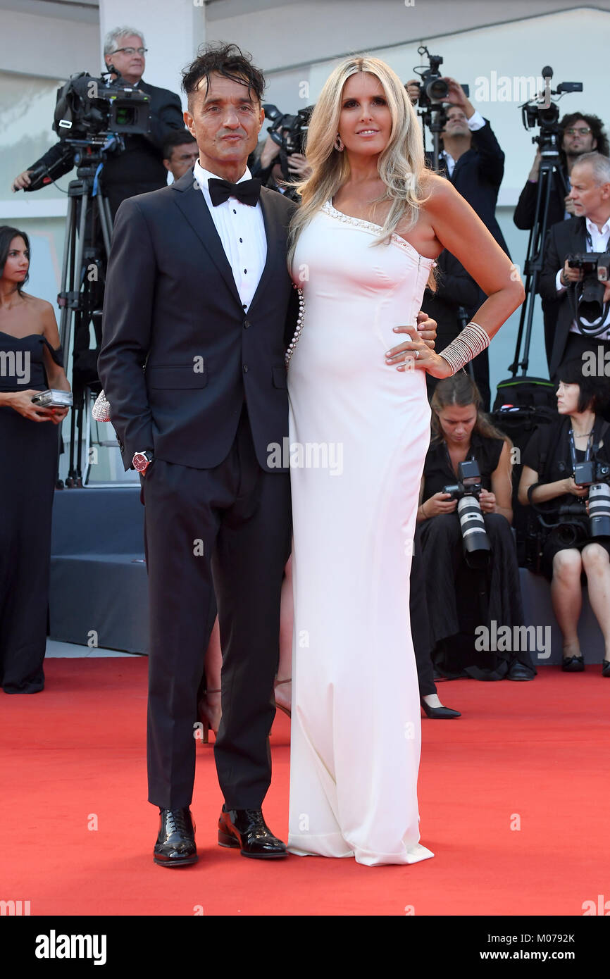 Giulio Base and Tiziana Rocca attend the Opening ceremony and Downsizing Premiere during the 74th Venice Film Festival. - Stock Image