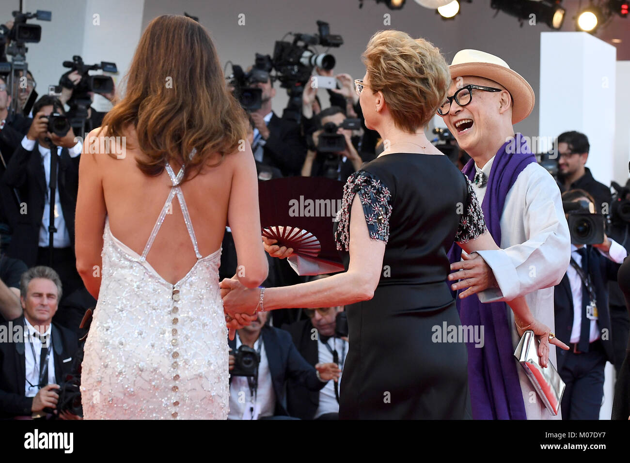 Anna Mouglalis, Annette Bening and Yonfan attend the Opening ceremony and Downsizing Premiere, 74th Venice Film - Stock Image
