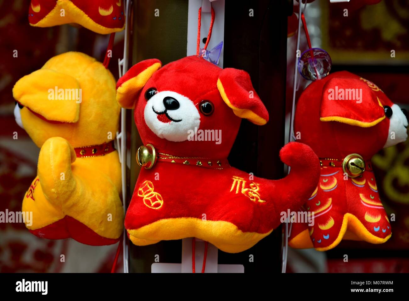 Toy dogs on sale in Chinatown during Lunar New Year in Singapore - Stock Image