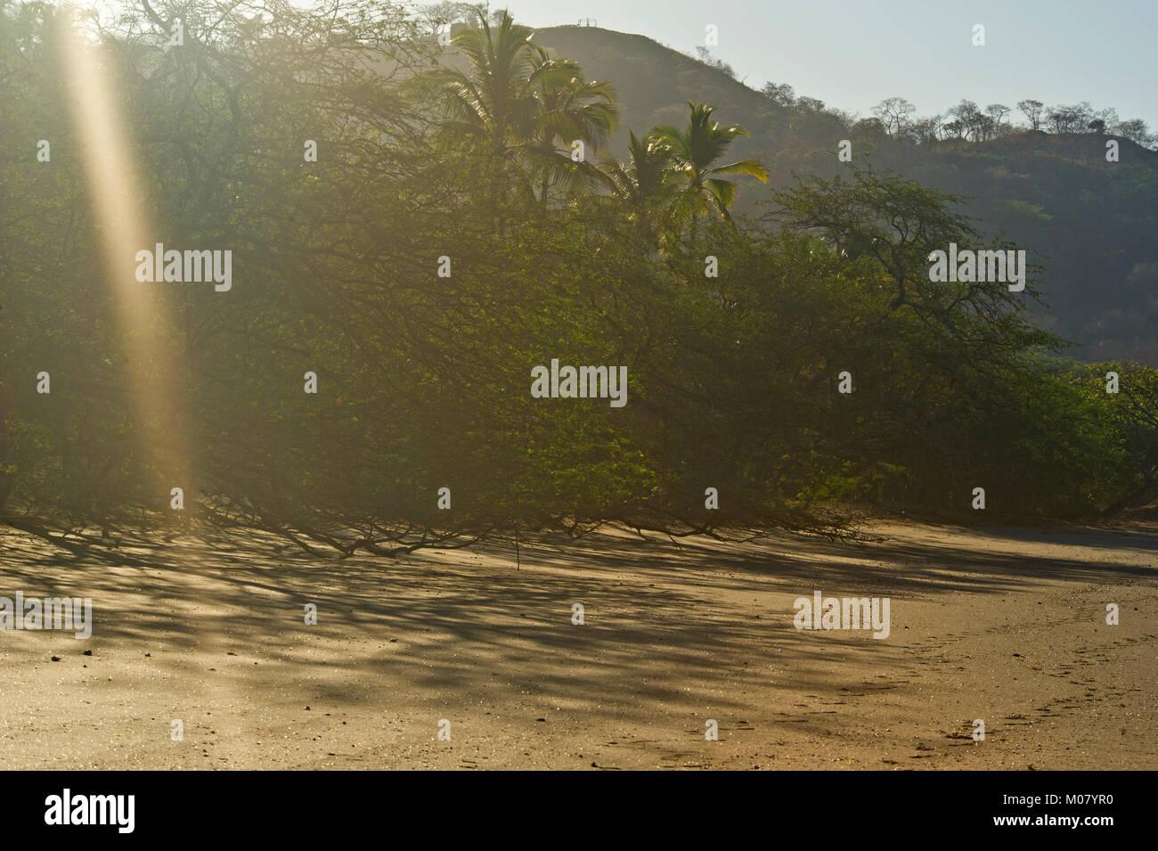 Sunrise on a black sand beach at Papagayo Bay. Stock Photo