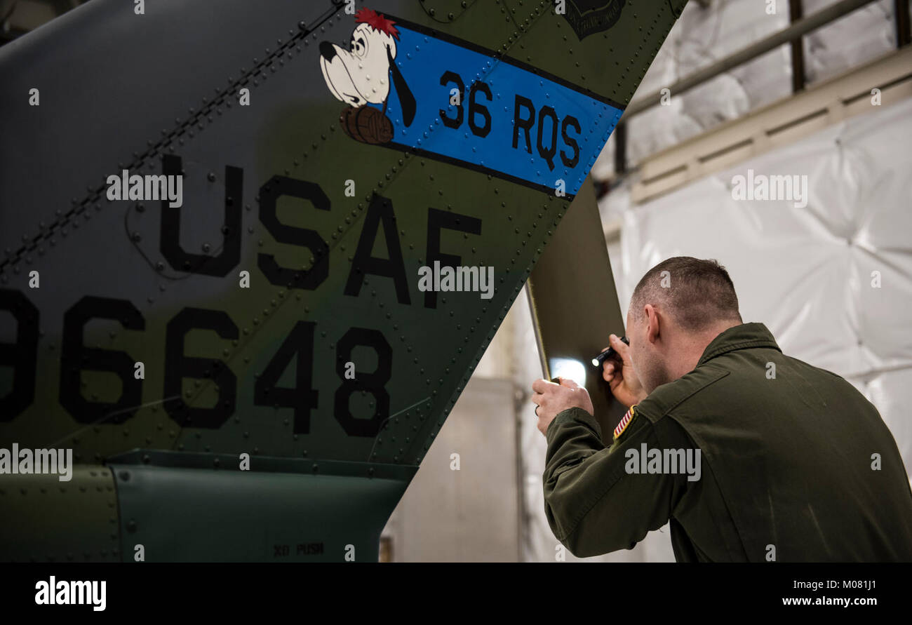 Master Sgt. Joshua Walker, 36th Rescue Squadron NCO in-charge of scheduling, conducts preflight checks before taking - Stock Image