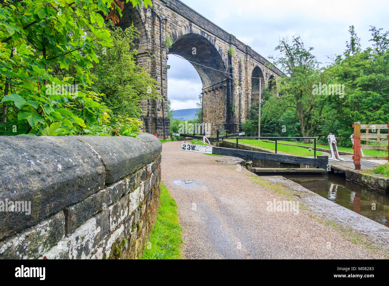 Lock, towpath, viaduct over the Huddersfield Narrow Canal, Uppermill, Oldham Lancashire, England, United Kingdom, - Stock Image