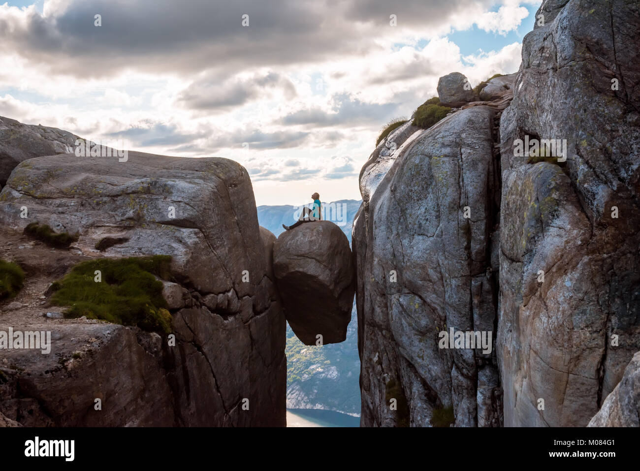 Woman on Kjeragbolten Travel in Norway - Stock Image