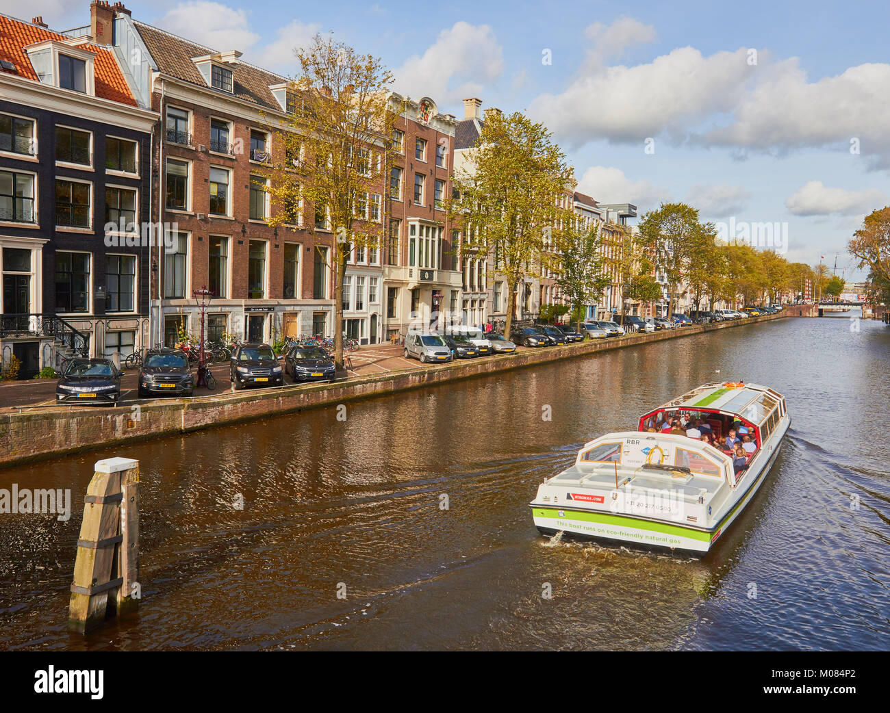 An eco-friendly tourist canal boat which runs on natural gas, Amsterdam, Netherlands - Stock Image