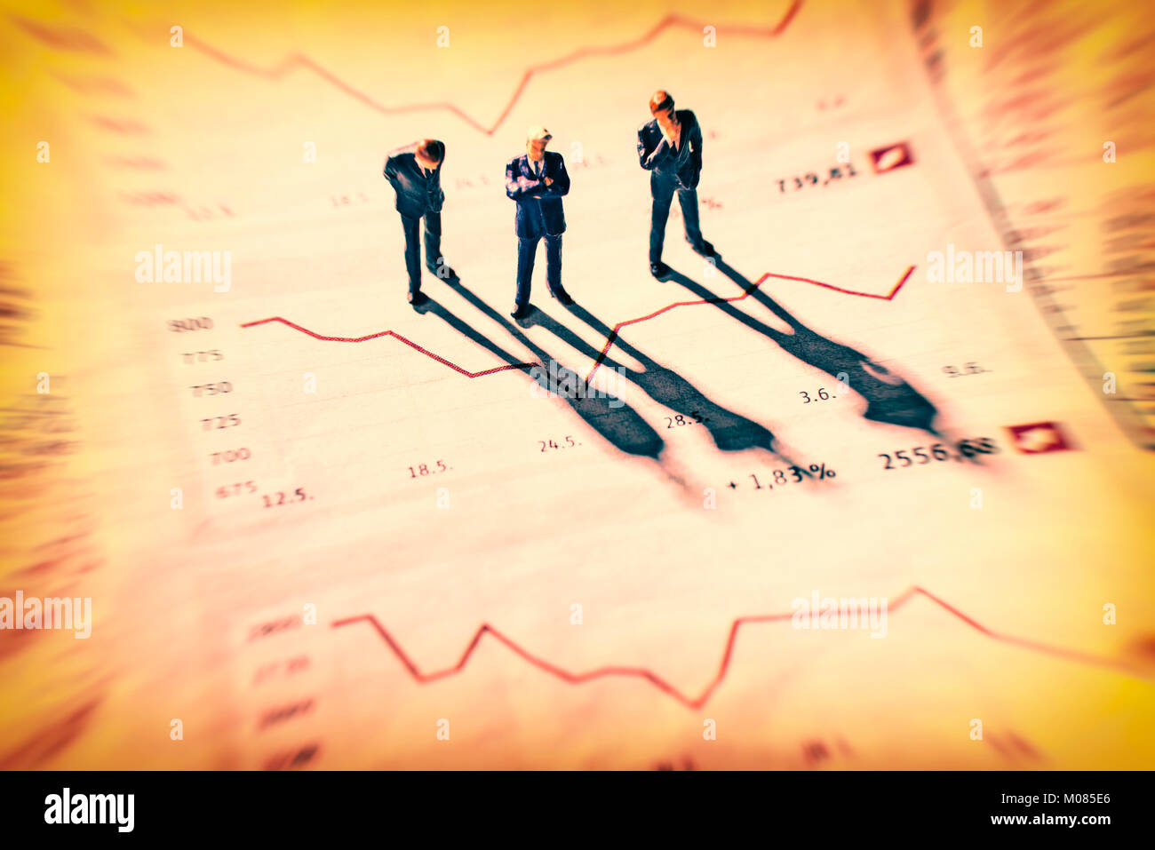 Businessmen are skeptical looking at stock market charts. - Stock Image