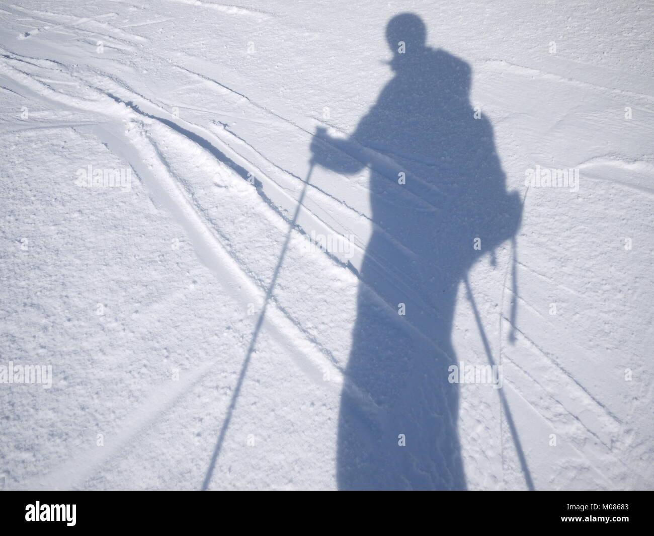 shadow someone skiing - Stock Image