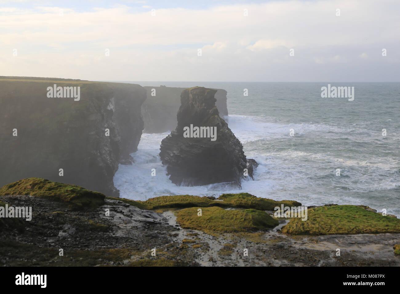 Waves crashing against the rocks and shoreline in Ireland, Wild Atlantic Way - Stock Image