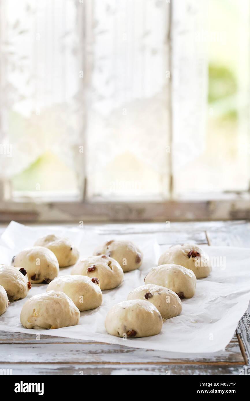 Raw unbaked buns - Stock Image