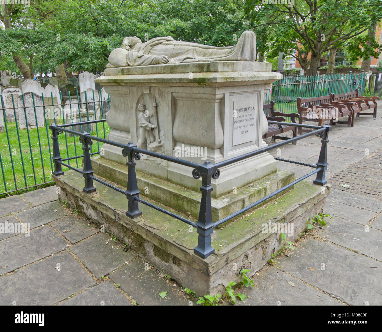 John Bunyan's tomb in Bunhill Fields, a fomer burial ground, in Islington, North London,  UK - Stock Image