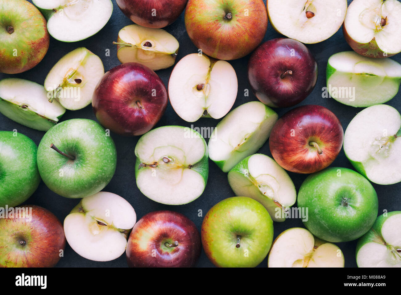 Red and Green apples on a slate background - Stock Image