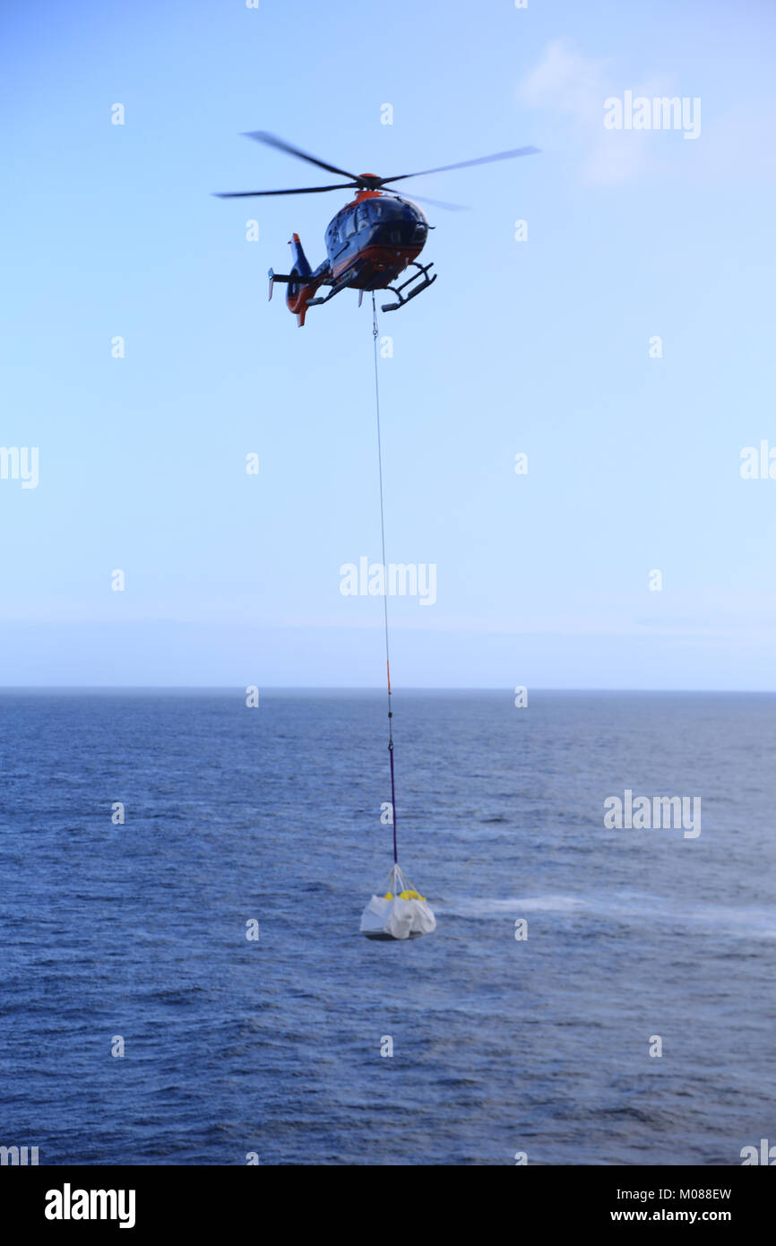 irish lights helicopter removing building material from an offshore irish coastal island, wild atlantic way, county - Stock Image