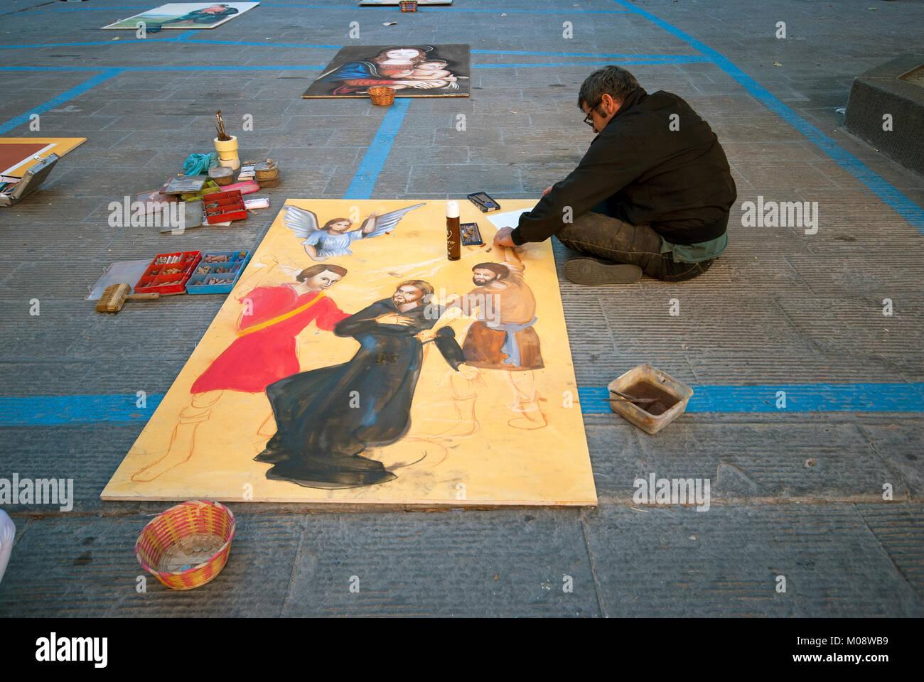 Street painter at work, Città della Pieve, Umbria, Italy - Stock Image