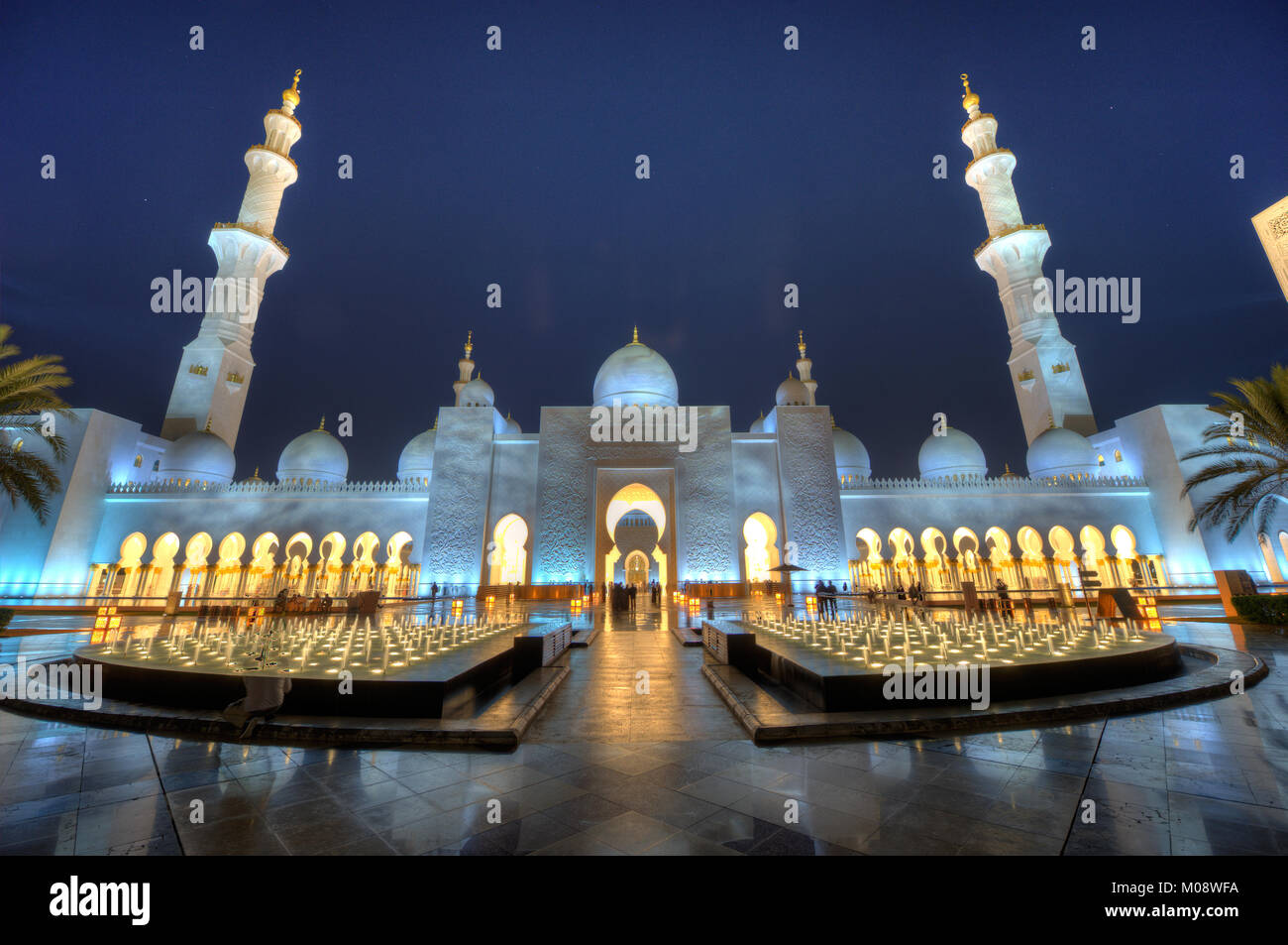 ABU DHABI, UNITED ARAB EMIRATES - DEC 31, 2017: Exterior of the Sheikh Zayed Mosque in Abu Dhabi in twilight. It - Stock Image