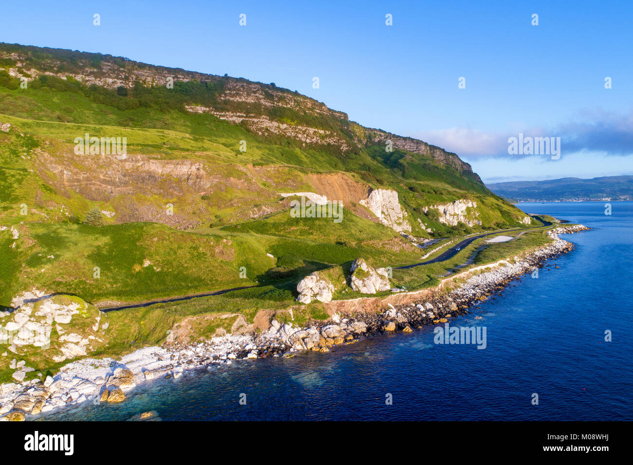 The eastern coast of Northern Ireland and Antrim Coast Road, a.k.a. Giant's Causeway Coastal Route with a cars. - Stock Image
